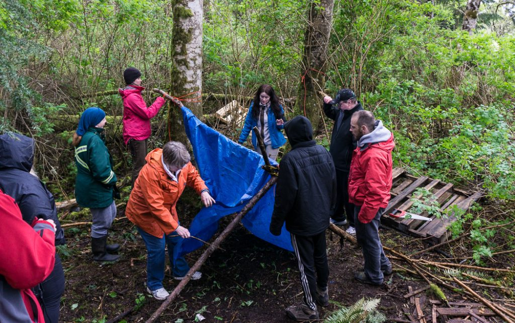 Learning to build a tarp shelter in a wilderness survival course with Megan Hanacek and Carleigh Fairchild