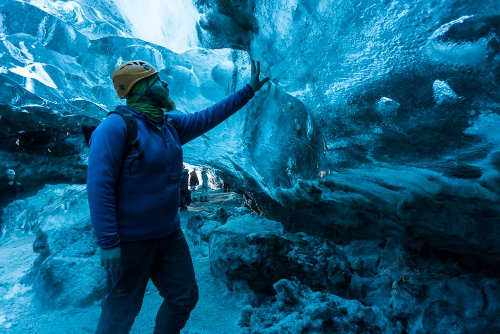 Inside an ice cave in Iceland. The Ultimate Guide to Ice Caves in Iceland: Everything you ever needed to know about visiting ice caves in Iceland. Find out how to go INSIDE the Crystal Cave glacier ice cave to see the blue ice.