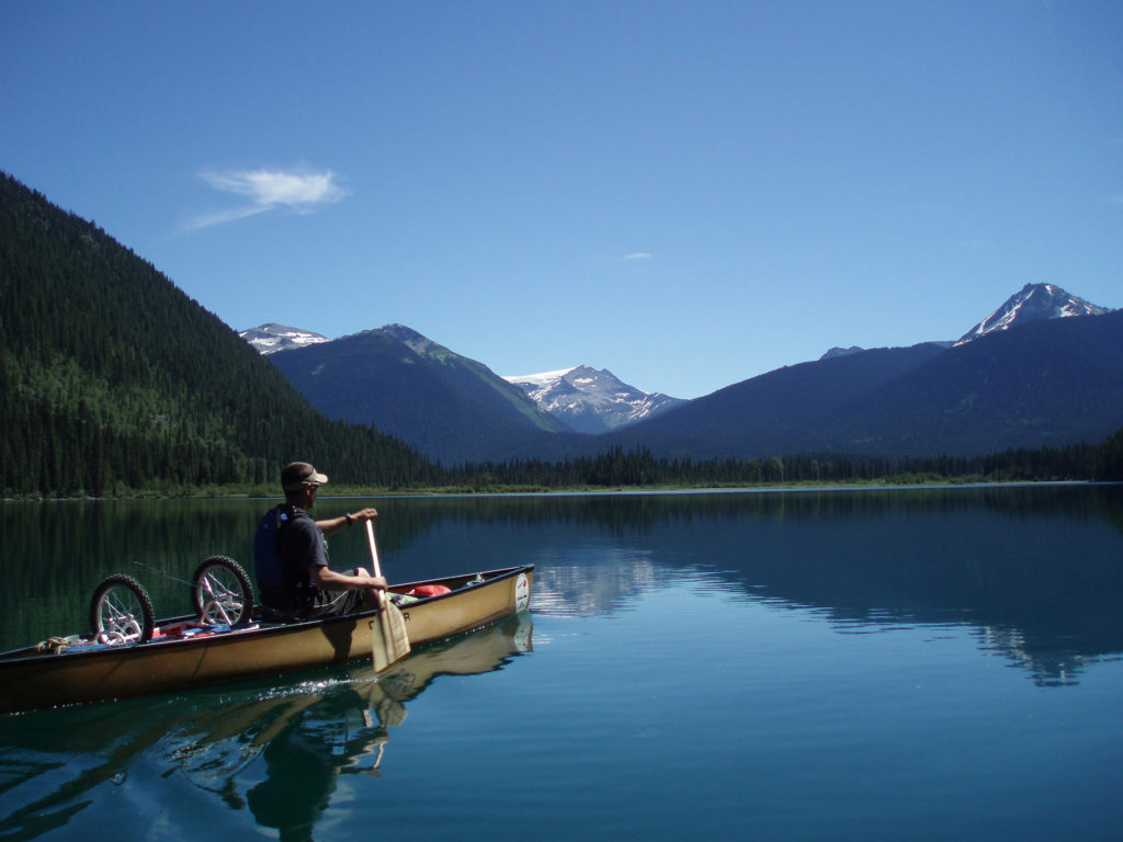 Canoeing on the Bowron Lakes. Find out how to reserve campsites on this trip: BC Backpacking Reservation dates you need to know