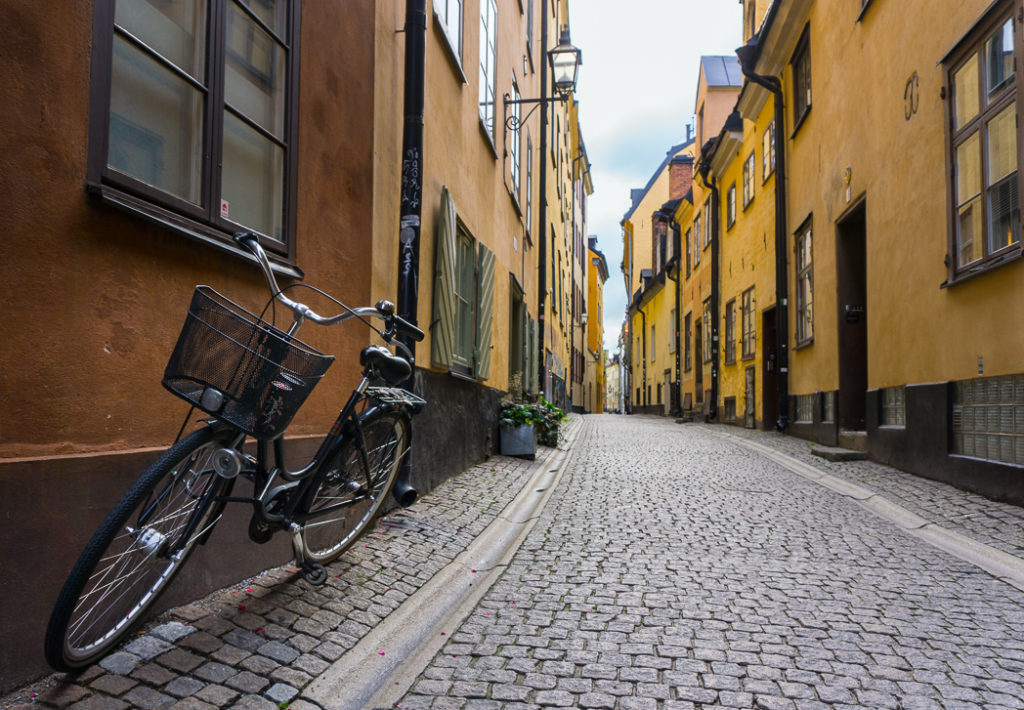 Prastgatan street in Stockholm's old town. 30 photos of Stockholm that will inspire you to visit.