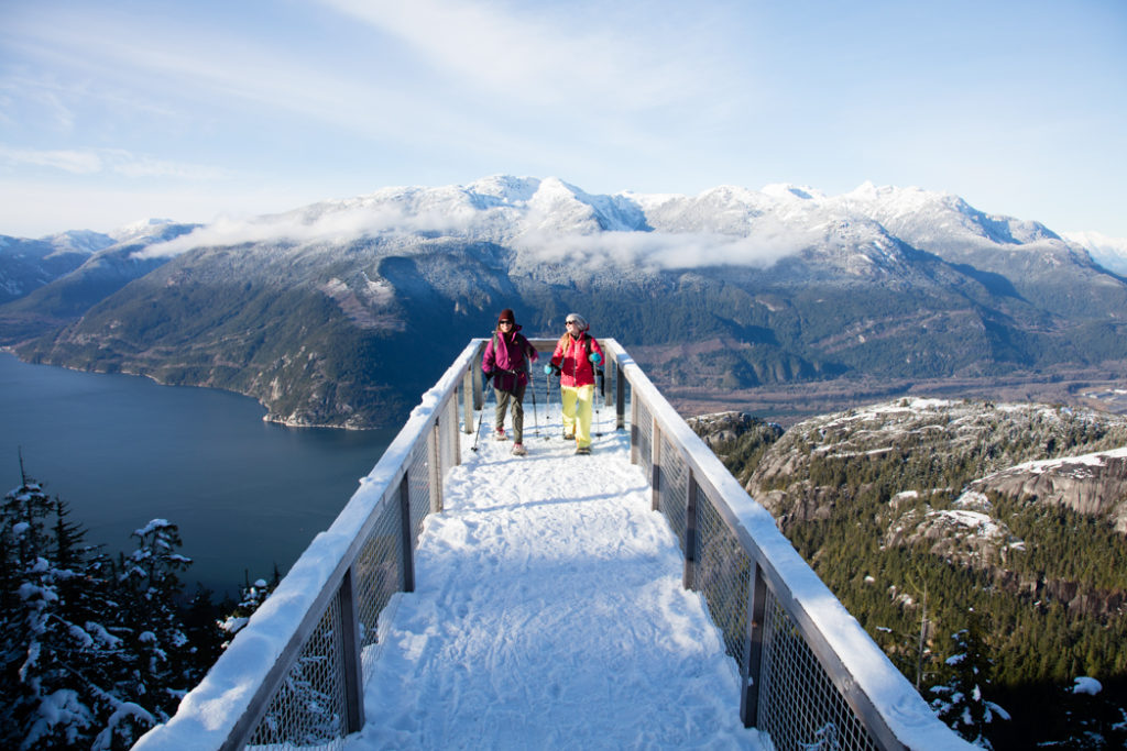 Snowshoeing at the Chief Viewing Platform on the Panorama Trail at the Sea to Sky Gondola in Squamish, BC. The Ultimate Guide to Snowshoeing in Squamish.