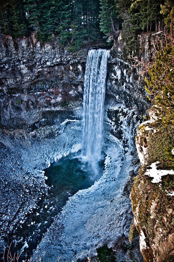 Brandywine Falls near Whistler in winter. Find out how to snowshoe here in the Ultimate Guide to Snowshoeing in Whistler, BC, Canada.
