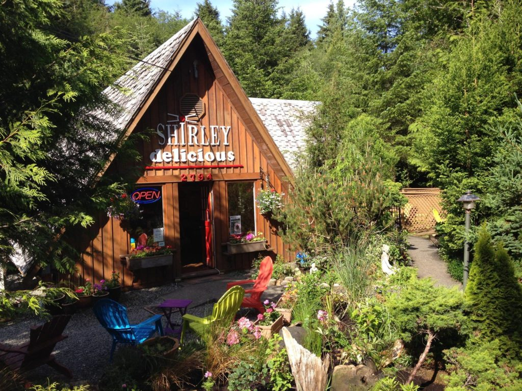 The exterior and patio of the Shirley Delicious cafe on the Pacific Marine Circle Route