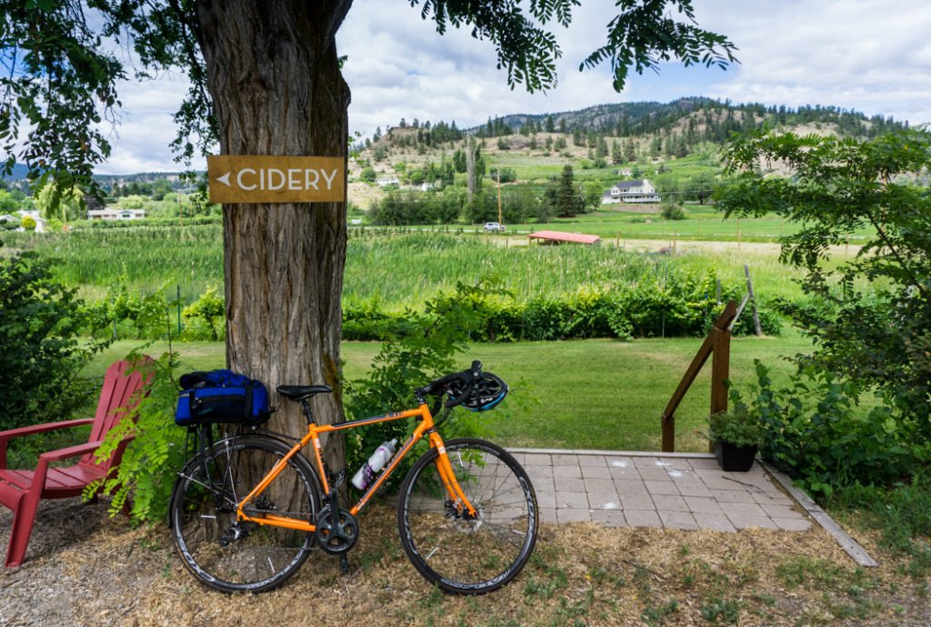 Cidery sign near Dominion Cider Co. in Summerland. Explore Summerland's wineries by bike with this self-guided tour.