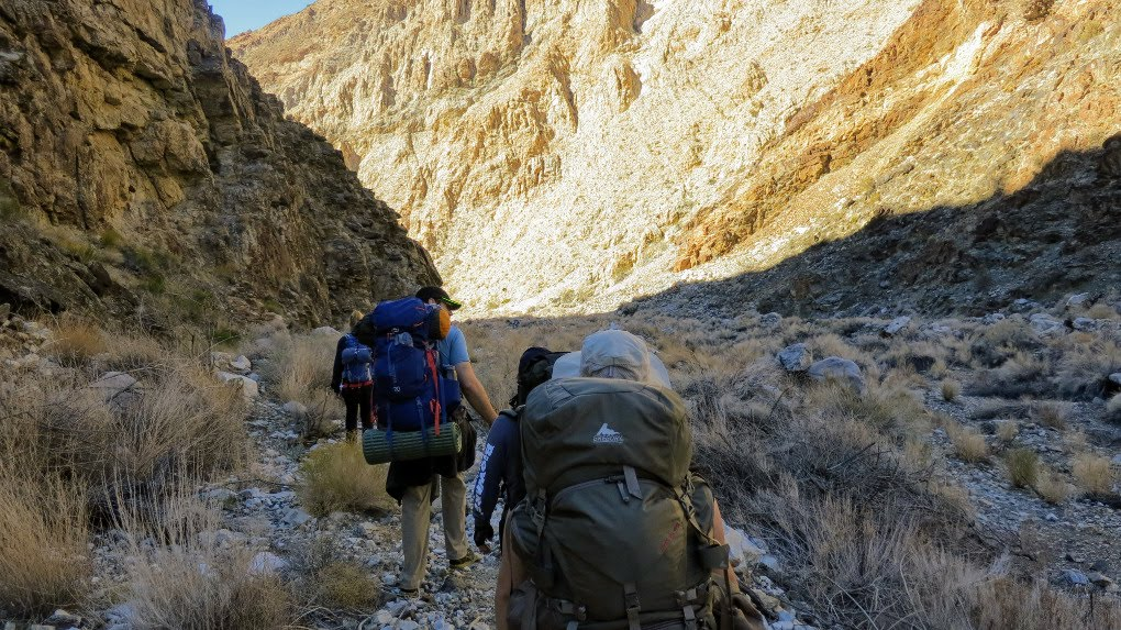 Hiking in Death Valley, California. Get tips for hiking in the desert including what gear you need, what to wear and how to stay safe.