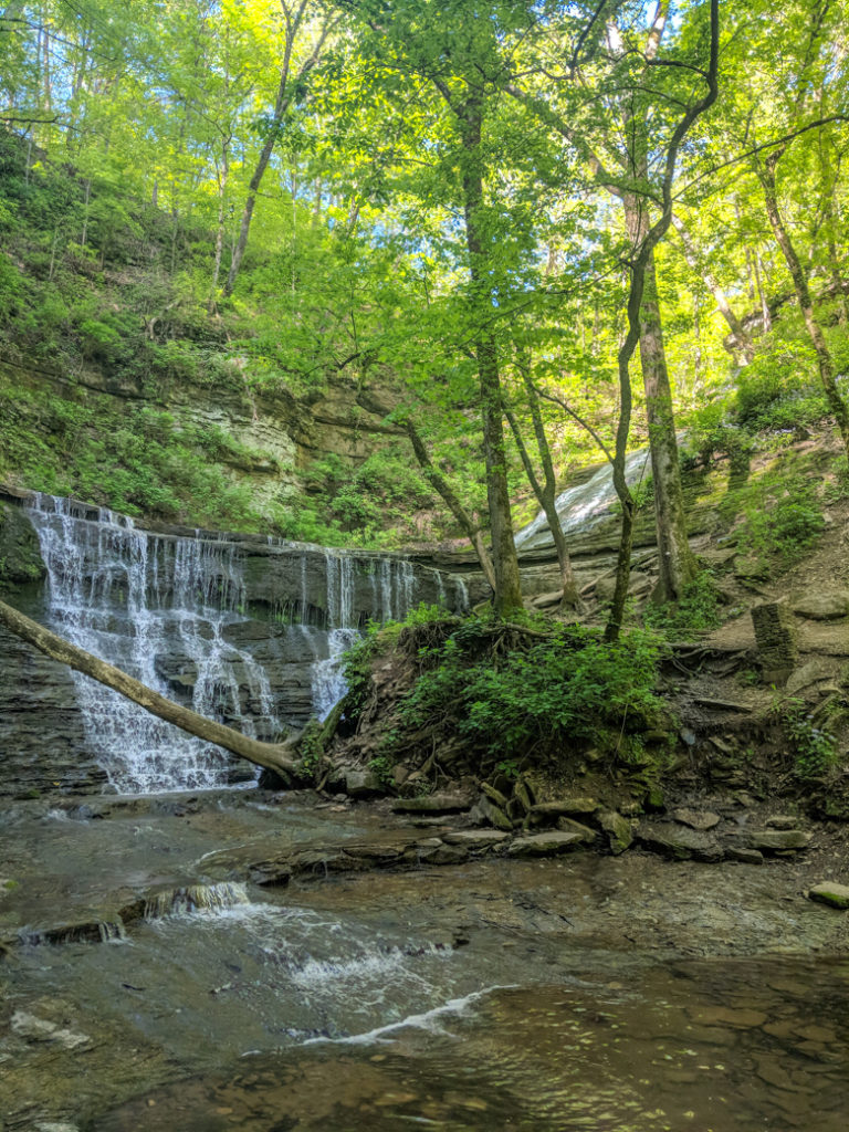 Jackson Falls on the Natchez Trace. Learn how to cycle tour the Natchez Trace Parkway in this detailed guide.