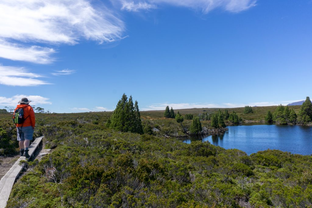 Hiking back from Lake Will. Take a day pack on all your Overland Track side trips for safety.