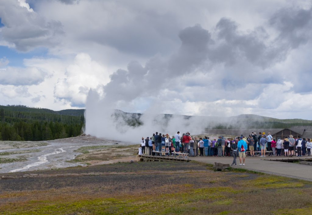 A crowd watching Old Faithful in Yellowstone National Park