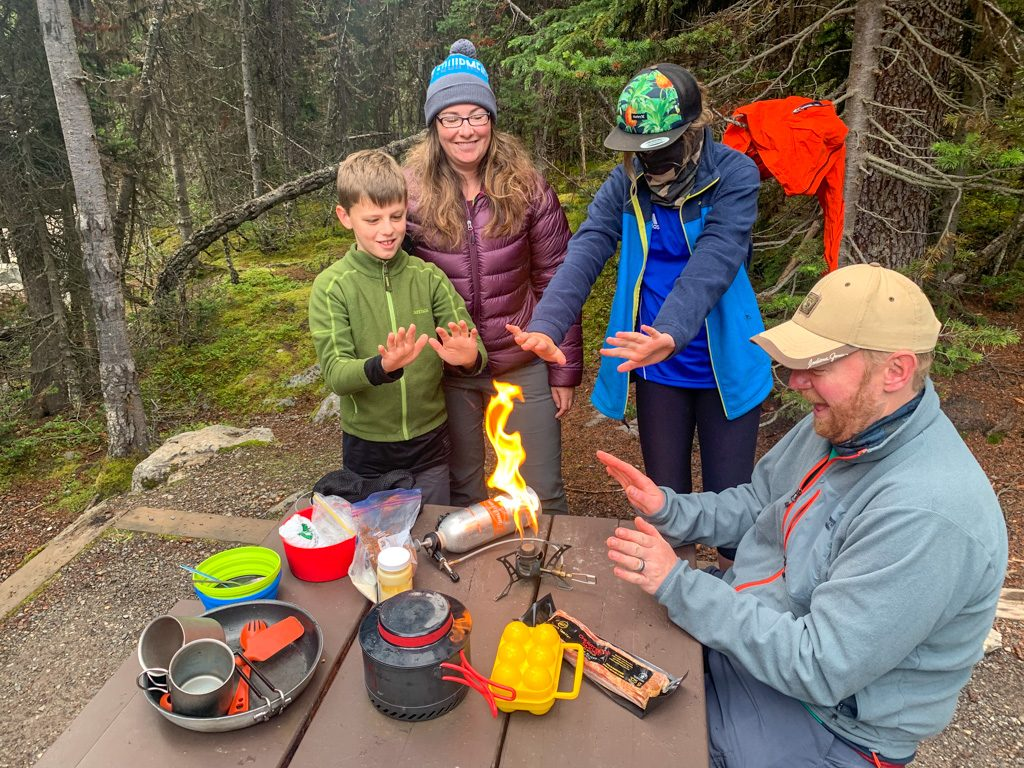 A group of campers cooking at the Lake O'Hara campground in Yoho National Park