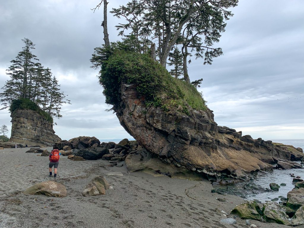Walking past sea stacks at low tide on the West Coast Trail