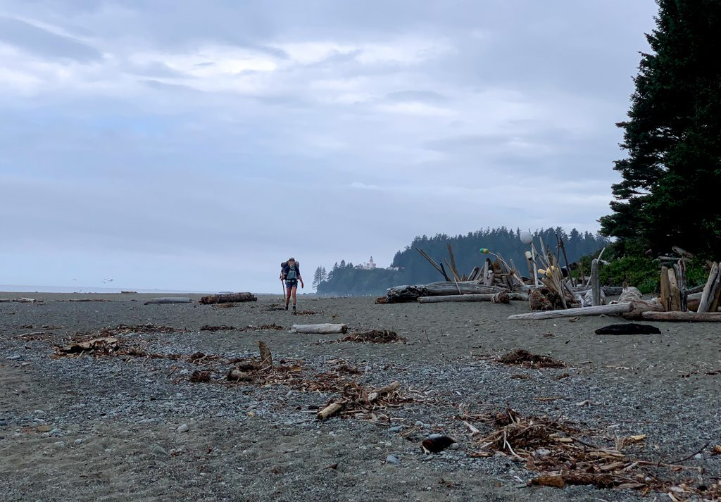 A hiker on the beach at Carmanah River on the West Coast Trail