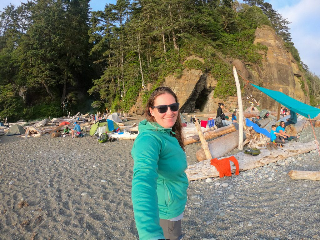A hiker at a beach campsite on the West Coast Trail. Read these tips for coastal hiking before your trip.