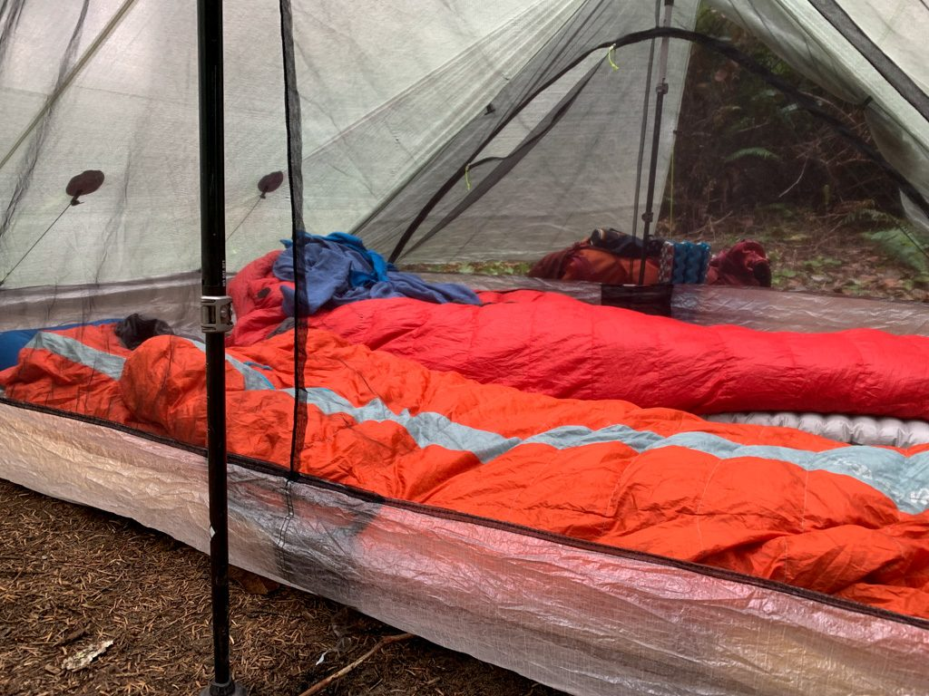 Sleeping bags set up inside a tent on the West Coast Trail