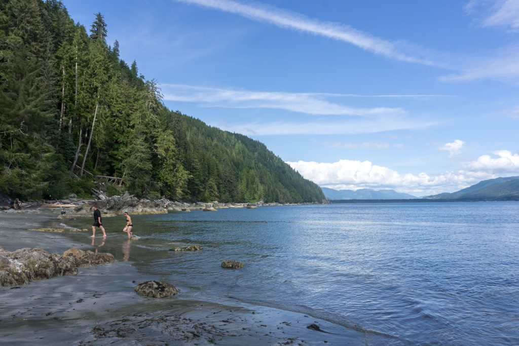 Hikers swimming at Thrasher Cove on the West Coast Trail