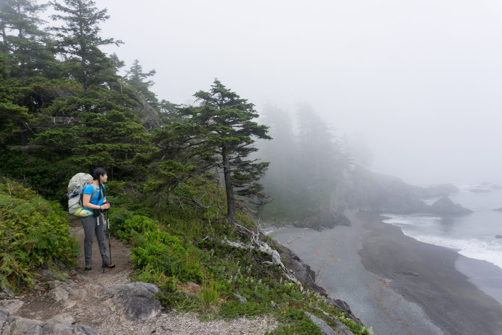 A hiker on a foggy bluff near Nitinaht Narrows on the West Coast Trail