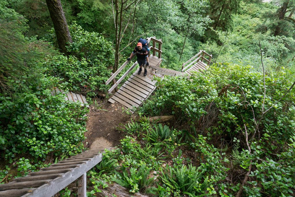 A hiker climbing the ladders at Cullite Creek on the West Coast Trail