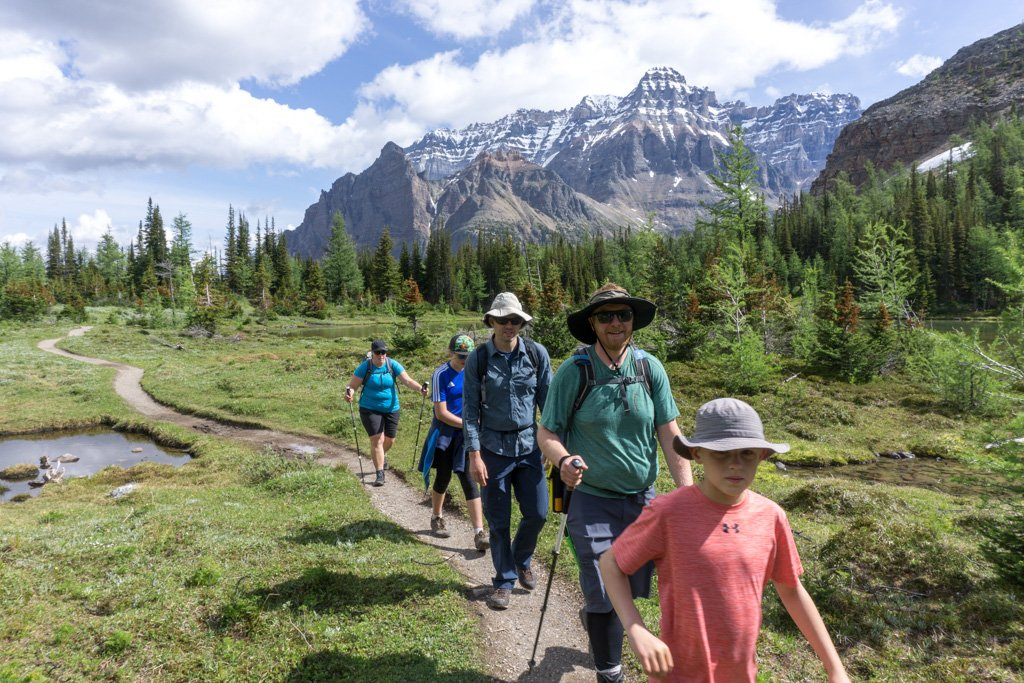 A group hiking at Lake O'Hara in Canada's Yoho National Park. Things to do before a hike