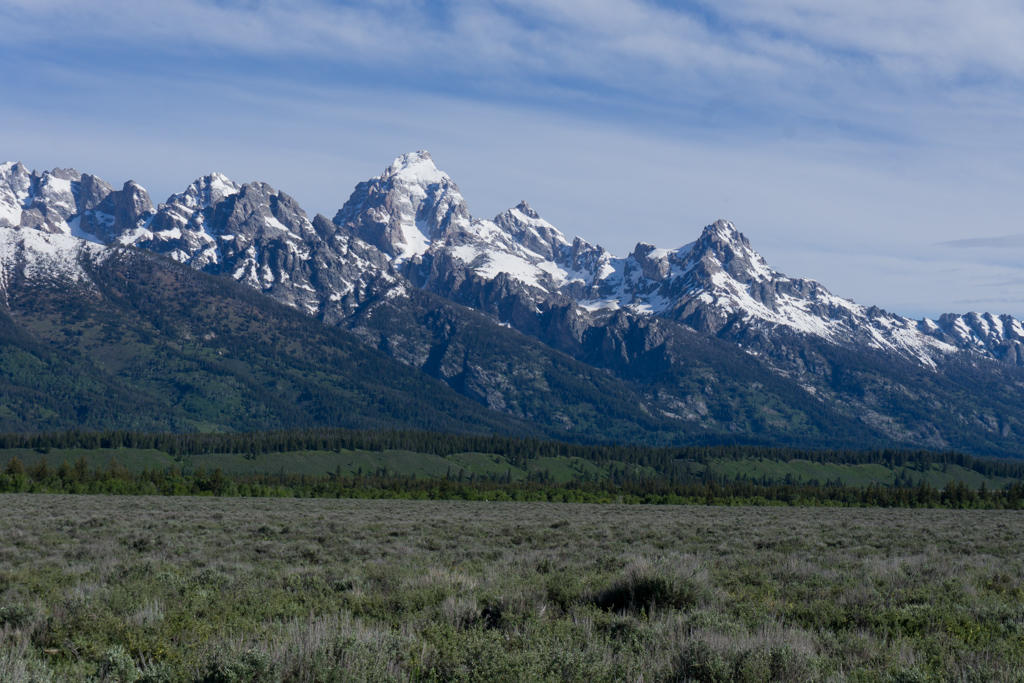 Snow covered mountains in Grand Teton National Park. 20+ Things to do in Grand Teton National Park