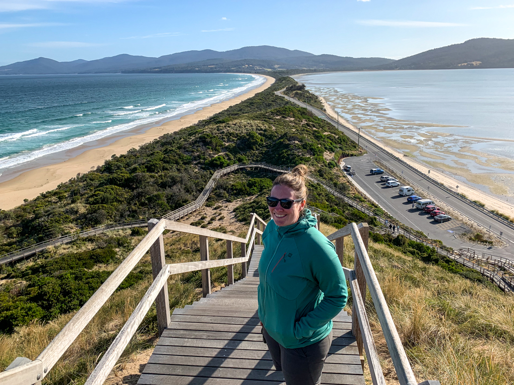 A woman standing at the top of a flight of stairs at the Neck on Bruny Island