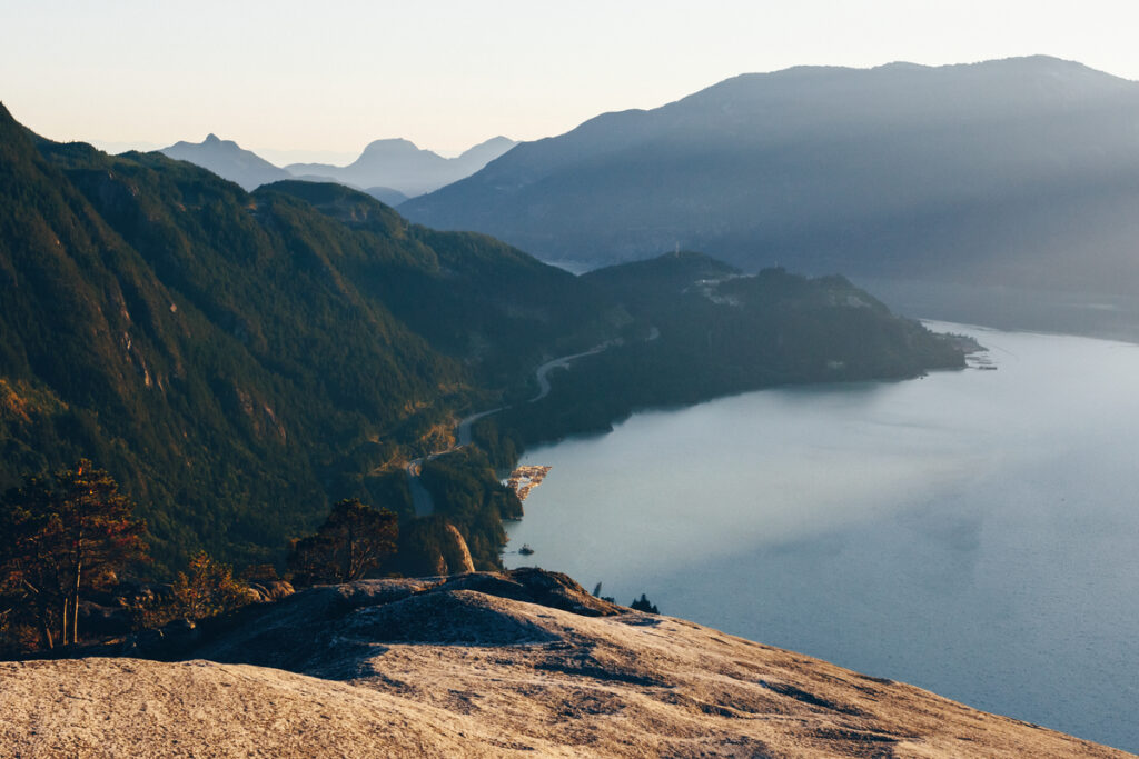 Hikers at the top of the Stawamus Chief in Squamish - one of the most most Instagrammed hikes in Vancouver