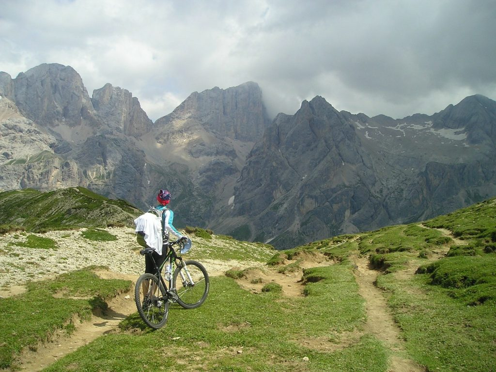 A woman rides a mountain bike in the mountains