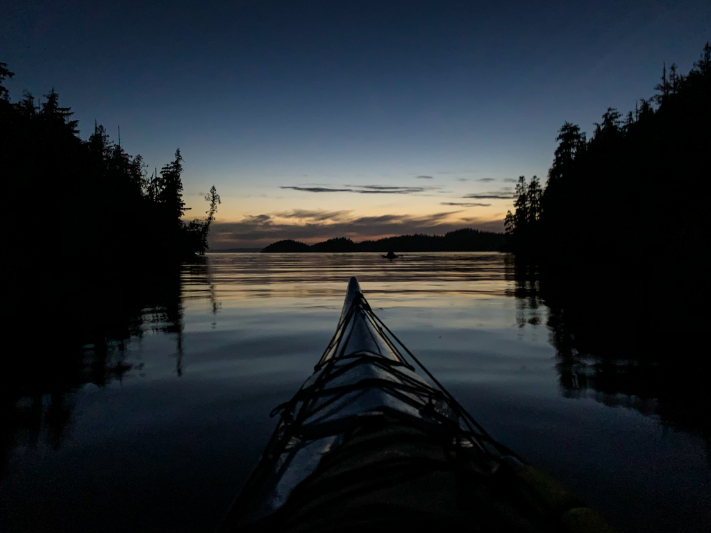 Paddling a kayak at night in the Johnstone Strait