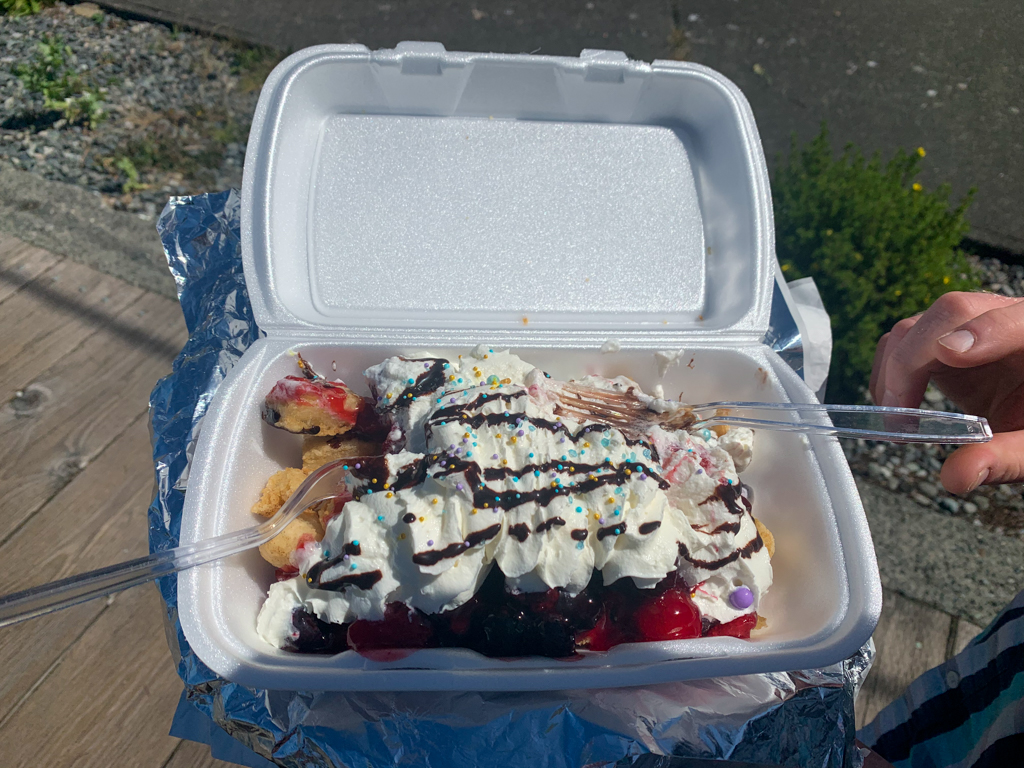 A dish of bannock fry bread with berries and whip cream from Duchess' Bannock in Alert Bay, BC
