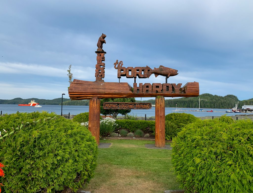 Carved wooden Welcome to Port Hardy sign at the waterfront in Port Hardy, BC