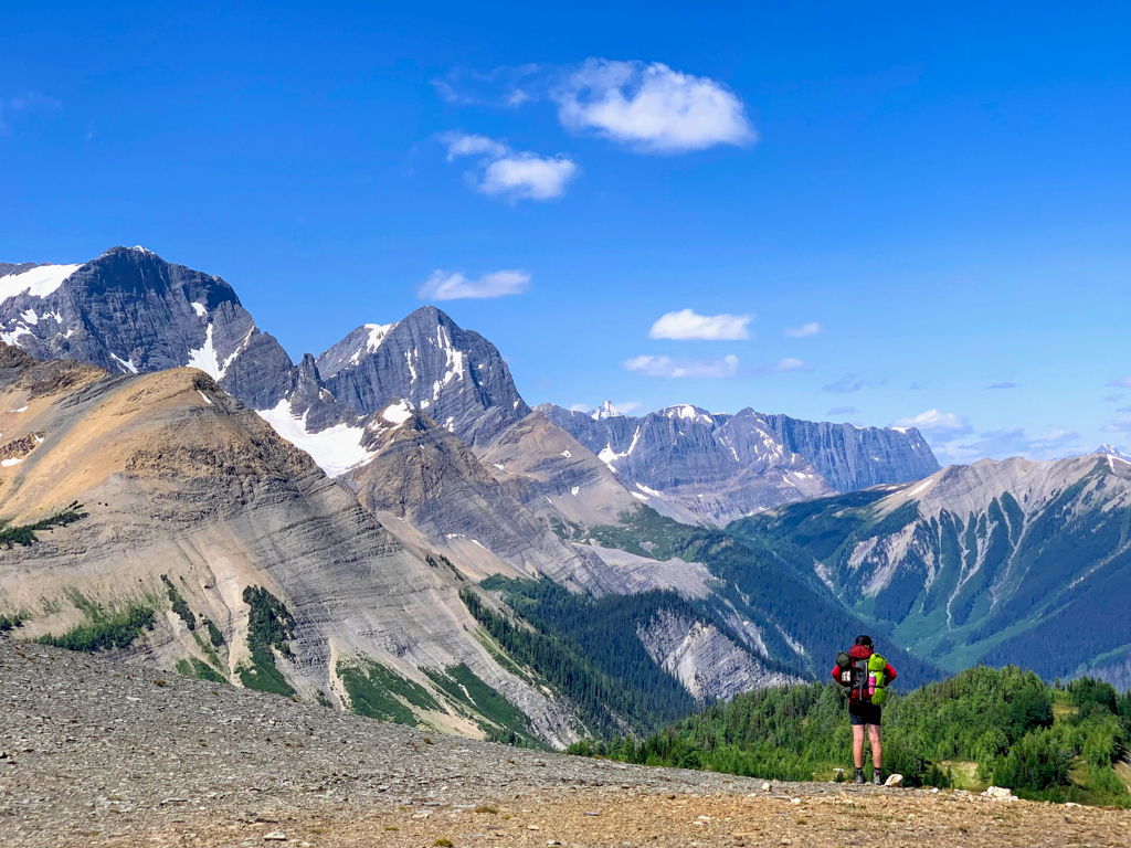 A hiker at Numa Pass on the Rockwall Trail