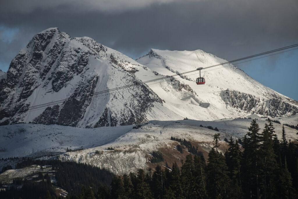 The Peak 2 Peak Gondola at Whistler crosses between snowy mountains
