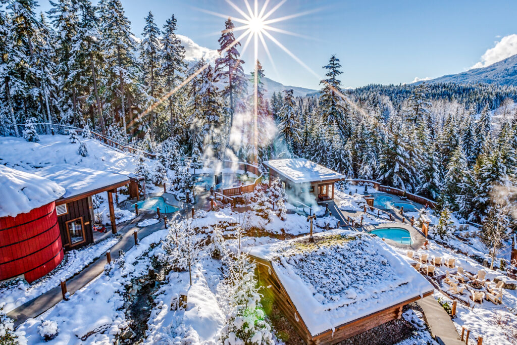 Outdoor hot pools in the snow at Scandinave Spa Whistler