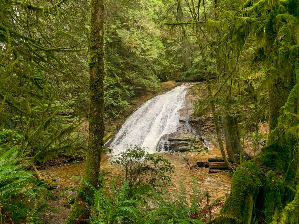 A waterfall cascades down a rock face in Roberts Creek on the Sunshine Coast, BC