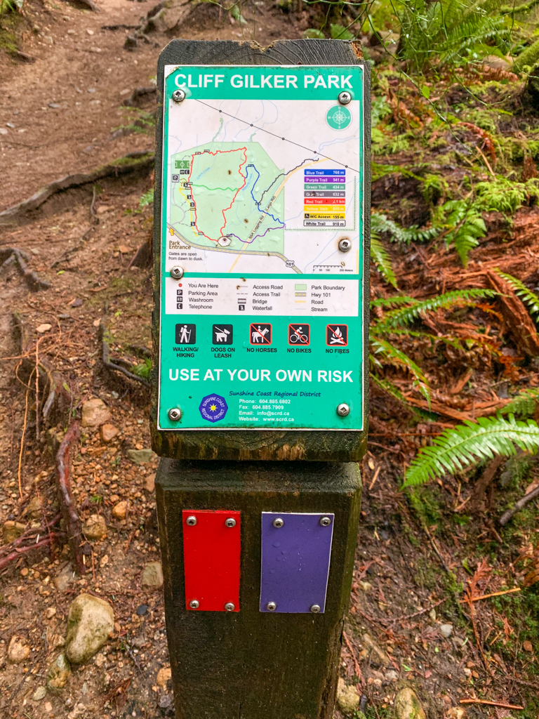 Mini trail map at an intersection in Cliff Gilker Park in Roberts Creek, BC