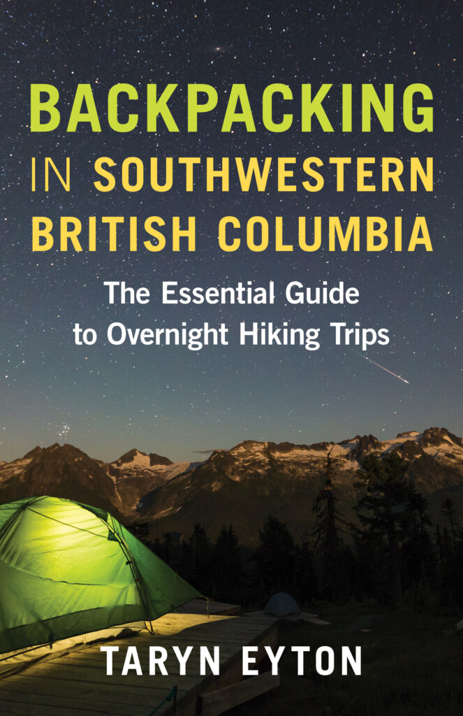 The front cover of the book Backpacking in Southwestern British Columbia by Taryn Eyton. It shows a tent near mountains and a starry sky.