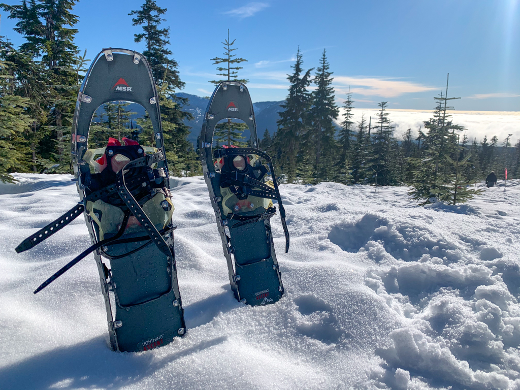 A pair of snowshoes propped up in the snow at Dakota Ridge on the Sunshine Coast, BC