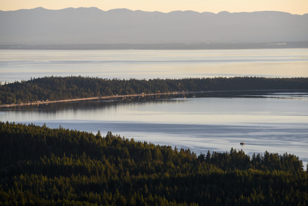Looking down to the sandy beaches of Savary Island from Manzanita Bluff on the Sunshine Coast Trail.