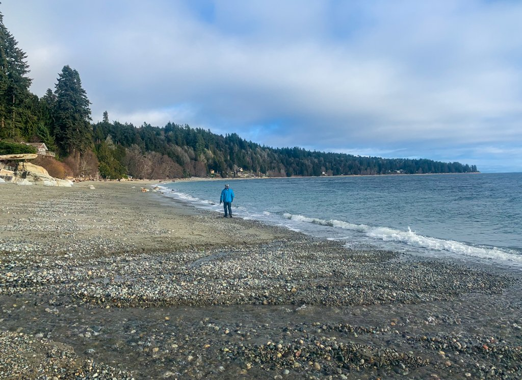 A man walks along Bonniebrook Beach in Gibsons on the Sunshine Coast BC