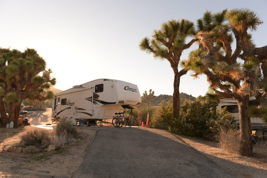 A 5th wheel RV at a campsite in Black Rock Campground - the best campground in Joshua Tree National Park for RVs