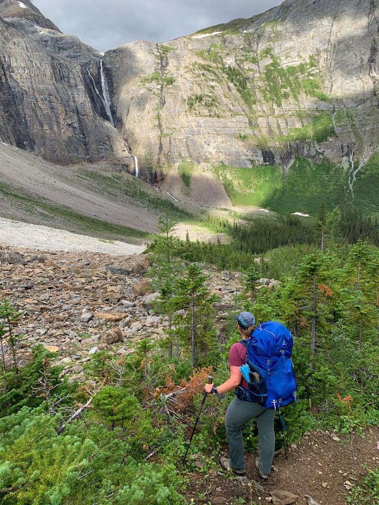 A woman looking across to Helmet Falls on the Rockwall Trail