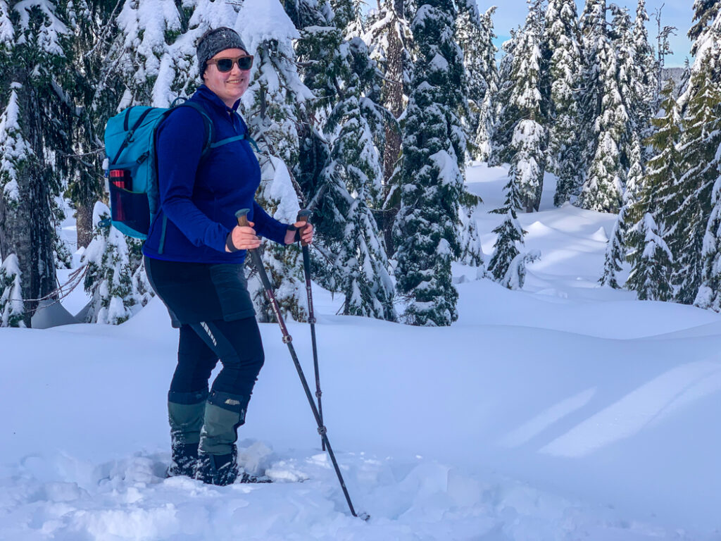 A female snowshoer wearing winter tights and an insulated skirt.