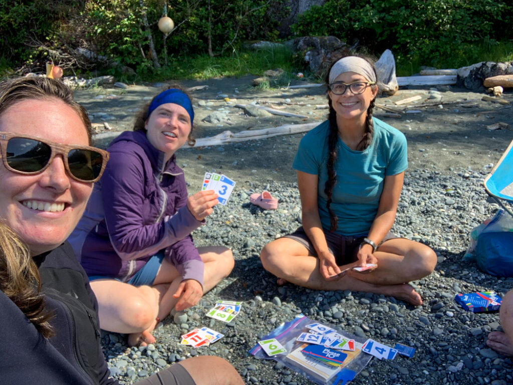 Hikers playing cards on the North Coast Trail