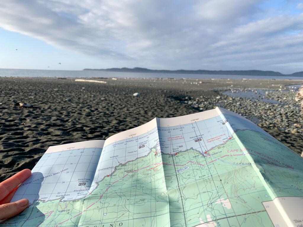 Looking at the North Coast Trail map at Skinner Creek