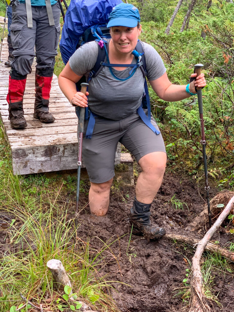 Hiker falling into the mud on the North Coast Trail