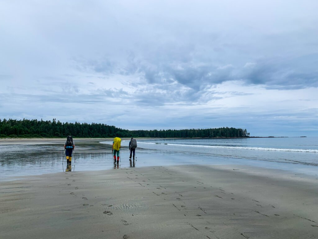 Hikers leaving Shuttleworth Bight on the North Coast Trail