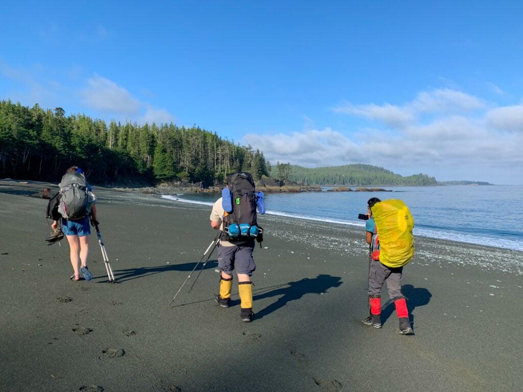 Hikers on the beach leaving Skinner Creek